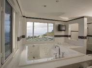 Master suite Bathroom at St Lucia's Luxury Holiday Villa Rental with Hot tub and TV