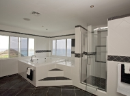 Master suite Bathroom at St Lucia's Luxury Holiday Villa Rental with Hot tub and TV and views