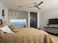 Blue Bedroom suite at St Lucia's Luxury Holiday Villa Rental with TV and Fan