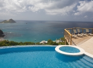 View from St Lucia's Best Holiday Villa Rental Living Terrace towards Pigeon Island over the pool and Sun Deck