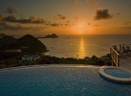 View from St Lucia's Best Holiday Villa Rental over the pool at Sunset