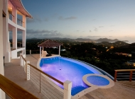 View from St Lucia's Best Holiday Villa Rental Dining Terrace over the pool towards Rodney Bay at sunset